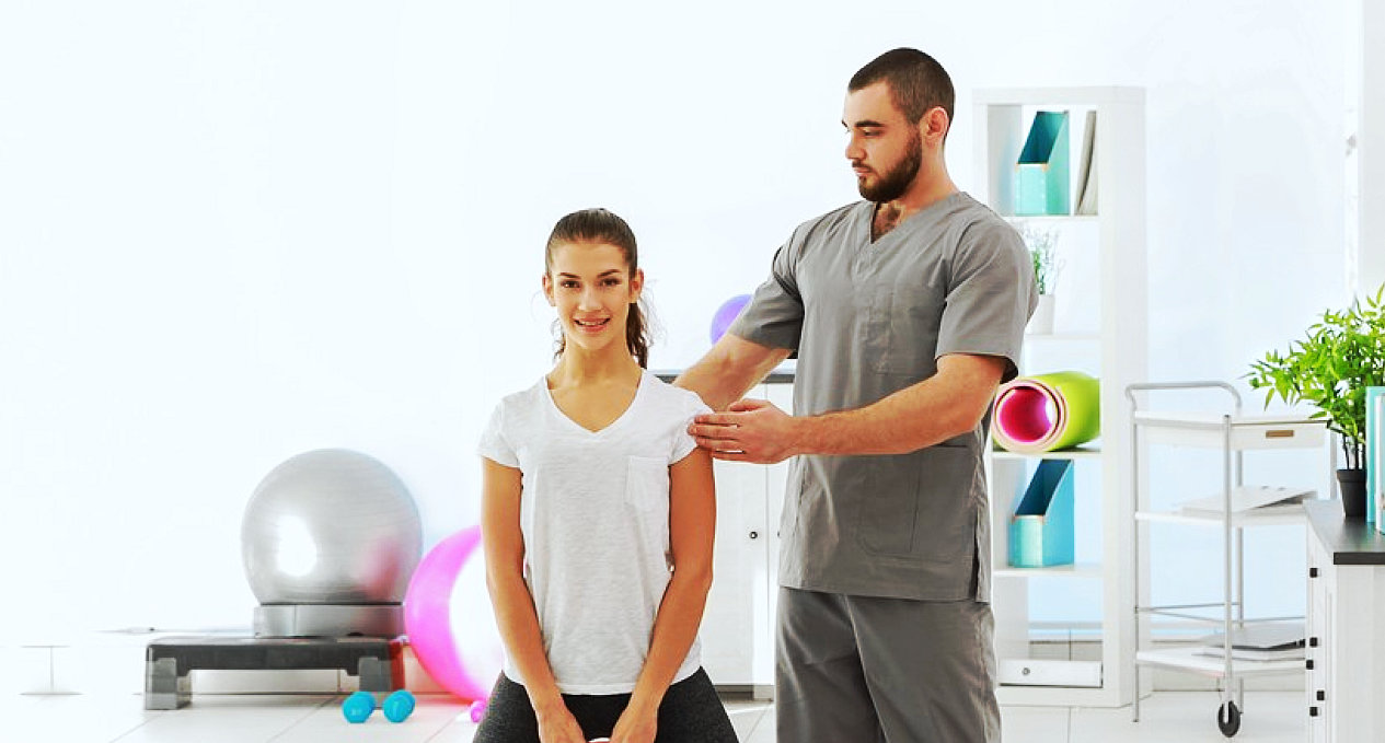 young male therapist instructing the young lady